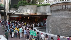 People stand in a queue at the funicular lifting of tourists to Victoria Peak, H Stock Footage