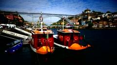 TL Portugal Porto Oporto Rabelo boats on river Douro and bridge Ponte Luis I Arkistovideo