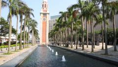 Clock Tower and a fountain on the embankment Kowloon Peninsula, Hong Kong Stock Footage