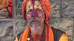Sadhu smokes cannabis in temple in Kathmandu, Nepal Stock Footage