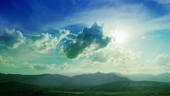 Stock Video Footage of Beautiful cloudy sky with shining sun and mountain range, time lapse