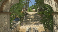 The entrance and stairs of the Mexican cemetery at Xcaret Park Stock Footage
