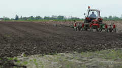 Tractor with a planter on the soil Stock Footage