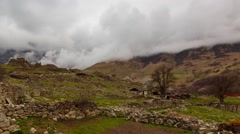 The formation of clouds in the ancient settlement - Dagom. - stock footage