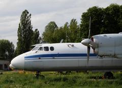 Propeller passenger plane at aircraft base - stock photo