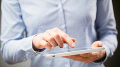 Woman Using a Tablet Device Stock Photos