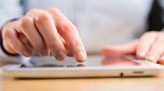Stock Photo of Person Using a Tablet Computer
