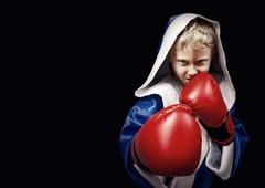 Danger looking little boxing fighter - stock photo