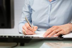 Business Person Signs a Contract Stock Photos