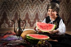 Eastern boy with watermelon portrait - stock photo