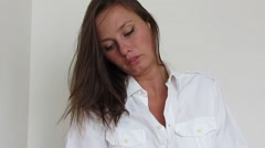 Girl in white shirt massaging her body Stock Footage