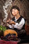 Little Aladdin with lamp - stock photo