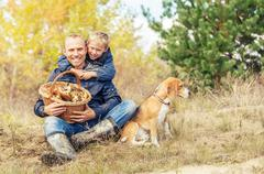 Family leisure in autumn forest - stock photo