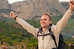 Feeling freedom man on the mountain landscape - stock photo