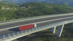 AERIAL: Flying above freight truck transporting the cargo on freeway - stock footage