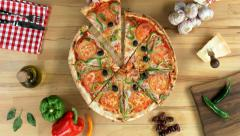 Sliced pizza, female (hands only) take one slice - stock footage