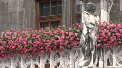 ULTRA HD 4K Beautiful old architecture city Munich red flower decoration statue  Stock Footage