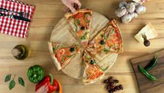 Sliced pizza, female, male (hands only) take slices Stock Footage