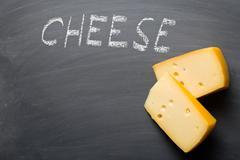 edam cheese on blackboard - stock photo