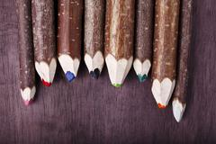 Decorative pencil on a brown background Stock Photos