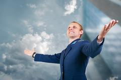 Happy young man aircraft pilot over blue sky  background - stock photo