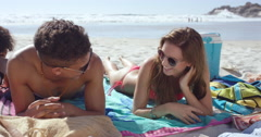 Multi racial couple with Group of friends hanging out on the beach on summer Stock Footage