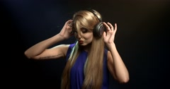 Listening to music through headphones Stock Footage