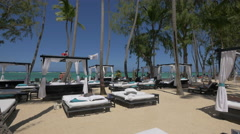 Canopy beds placed on the beach in the Dominican Republic - stock footage
