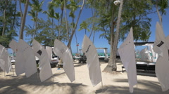 Flags and canopy beds on the beach in the Dominican Republic Stock Footage