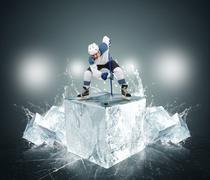 Hockey player with ice cubes - stock photo