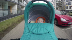 Baby sleep in his pushchair stroller while walking outdoor. 4K Stock Footage
