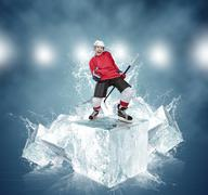 Screaming hockey player on abstract ice cubes background - stock photo