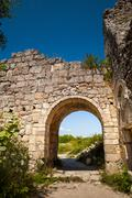 Archway in citadel ruins - stock photo