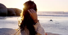 Portrait of beautiful girl smiling on beach at sunset in slow motion - stock footage