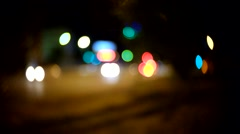 Evening traffic. The city and car lights. C-mount lens circular bokeh blur - stock footage