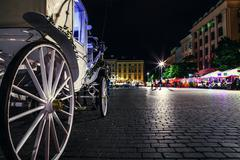 Close up image carriage wheel on main square of olf city in Krakow - stock photo