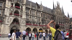 ULTRA HD 4K Tourist people enjoy Munich landmark take photo Marys Square iconic  Stock Footage