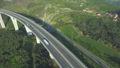 AERIAL: Freight truck driving over the viaduct highway - stock footage