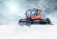 Stock Photo of Tractor cleaning snow outdoors