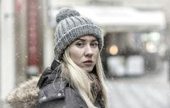 Stock Photo of Woman in grey winter hat in the city