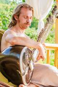 Man playing on indian traditional musical instument - sitar - stock photo