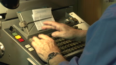 Obsolete technology - Linotype, typing hands - stock footage