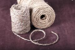 skein of twine on a brown background - stock photo