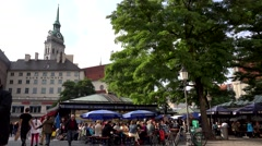 ULTRA HD 4K Timelapse people relax terrace old town Munich downtown crowd emblem Stock Footage