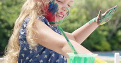Cute preschooler learning how to paint little girls painting on face - stock footage