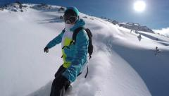 SELFIE: Snowboarder riding powder on a sunny mountain in winter - stock footage