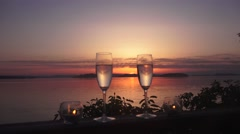 Setting sun and wine glasses Stock Footage