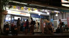 Time lapse of travel agency in night BKK Stock Footage