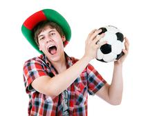 Portuguese screaming football fan on the white background Stock Photos