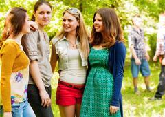Four girlfriends outdoor portrait - stock photo